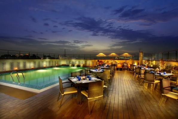Terrace grill at mahagun sarovar portico hotel in - Swimming pool in vaishali ghaziabad ...