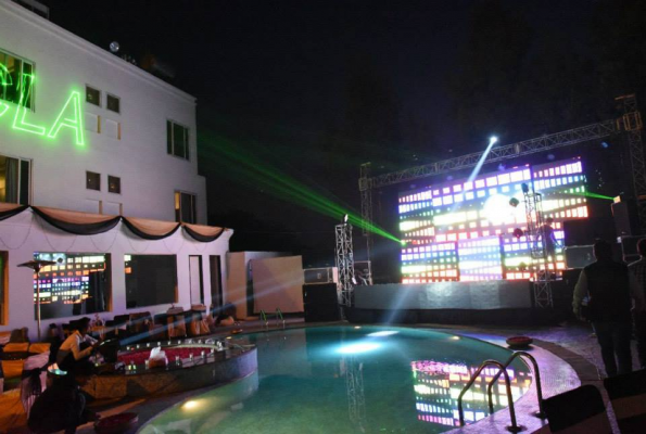 Pool side at the chandigarh ashok hotel in chandigarh - Chandigarh hotel with swimming pool ...